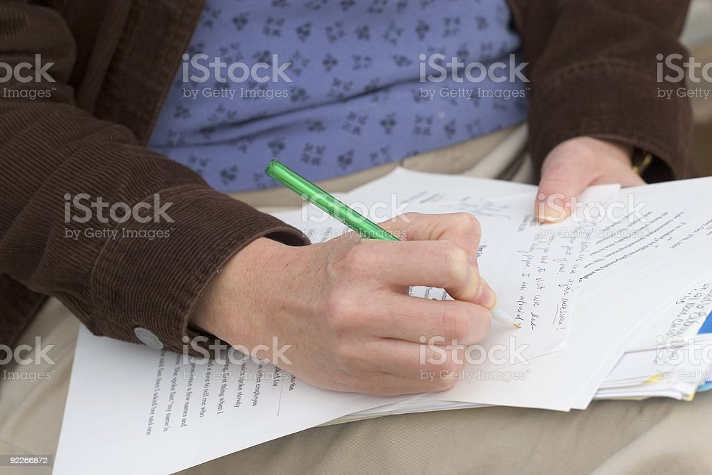Woman Grading Papers royalty-free stock photo