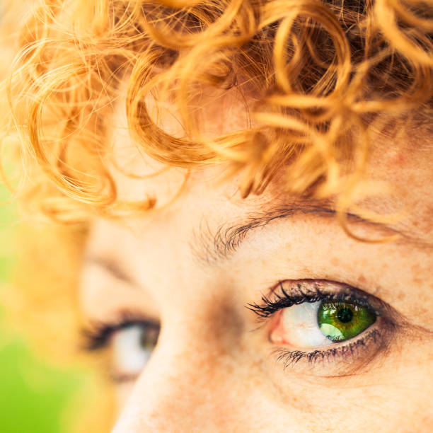 woman green eye and curly red hair - woman green eyes red hair stock photos and pictures