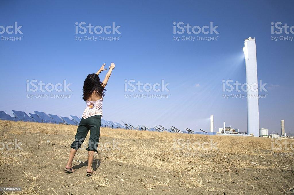 woman greeting renewable solar power tower royalty-free stock photo