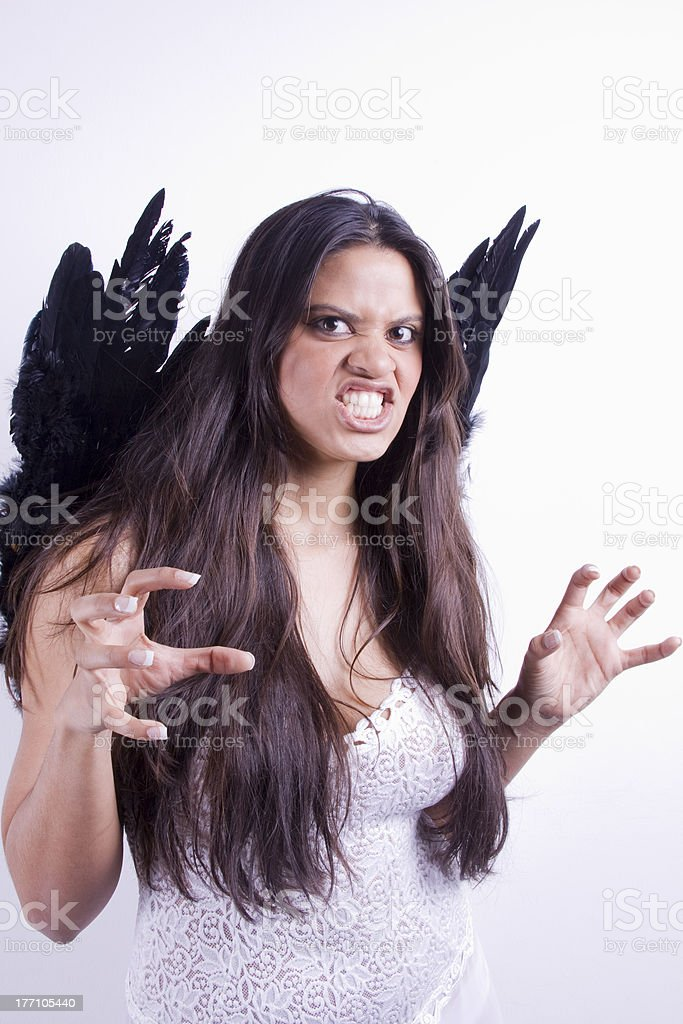 Woman Gritting her teeth and ready to attack you stock photo