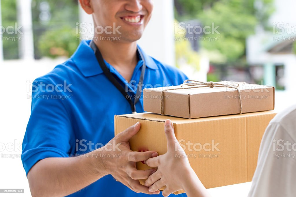 Woman hand accepting a delivery of boxes from deliveryman Woman hand accepting a delivery of boxes from deliveryman Adult Stock Photo