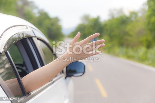 istock Woman hand at the car window 836102414