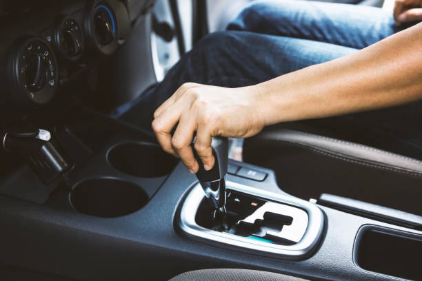 Woman hand changing gear while driving scene stock photo