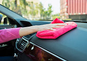 Woman hand cleaning car interior