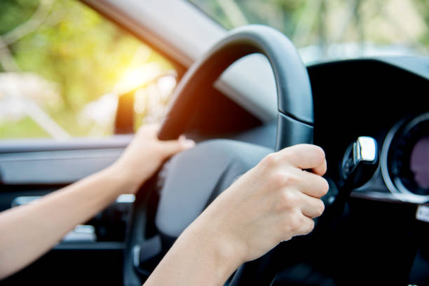Woman hand driving stock photo