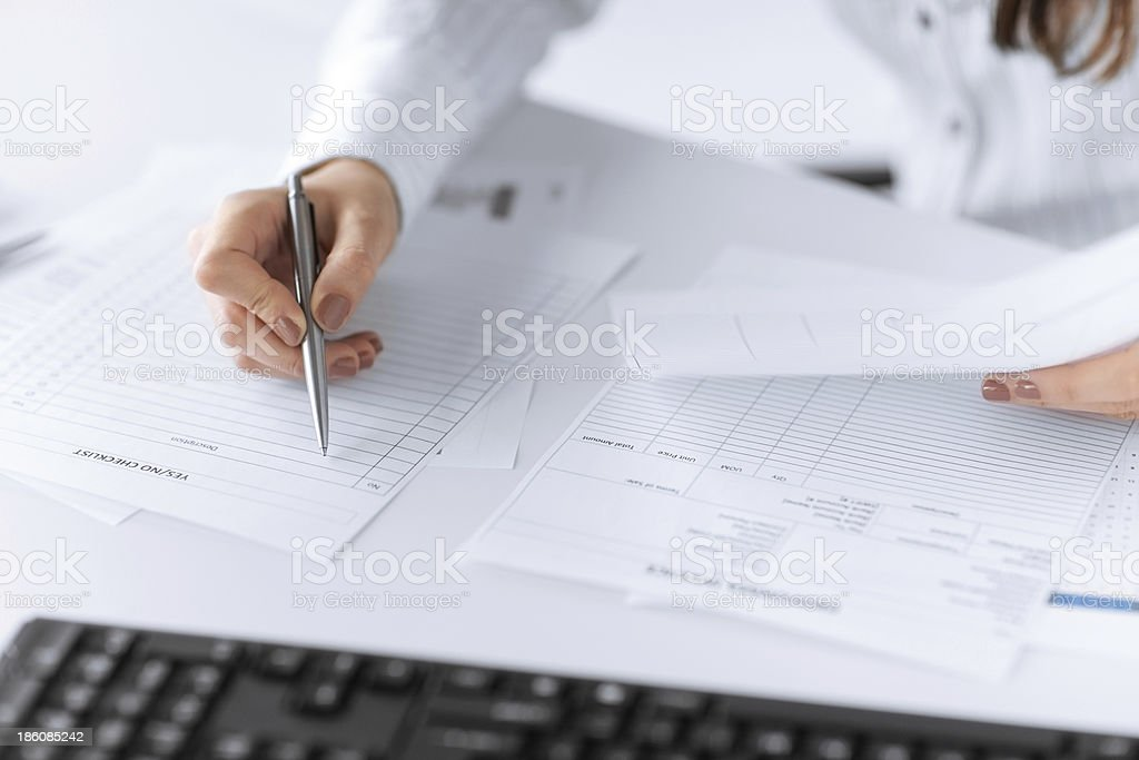 woman hand filling in blank paper or document stock photo