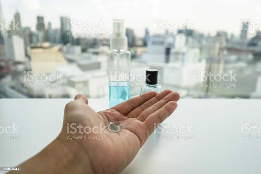 woman hand full with alcohol for hygiene and sanitizer stock photo
