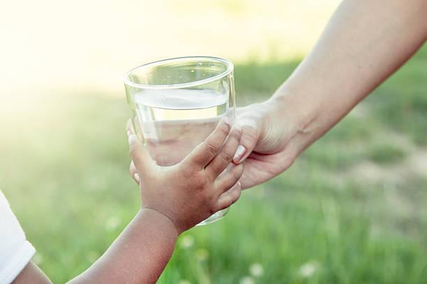 Woman hand giving glass of fresh water to child picture id494128288?b=1&k=6&m=494128288&s=612x612&w=0&h=0v9whmur4c08ke xv evpnya0j5pkexvkknqejwrdpy=