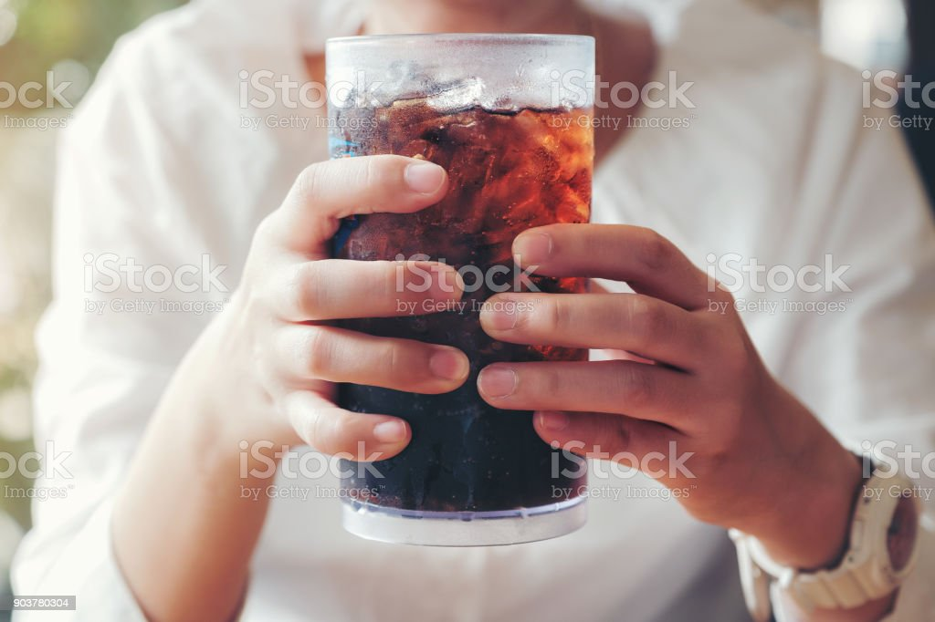 Woman hand giving glass ,Soft drinks with ice, sweethart or buddy stock photo