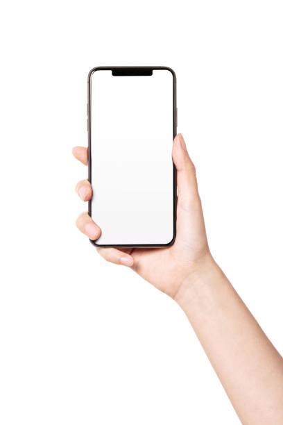 la donna tiene a mano uno smartphone dritto isolato su bianco. - smart phone foto e immagini stock