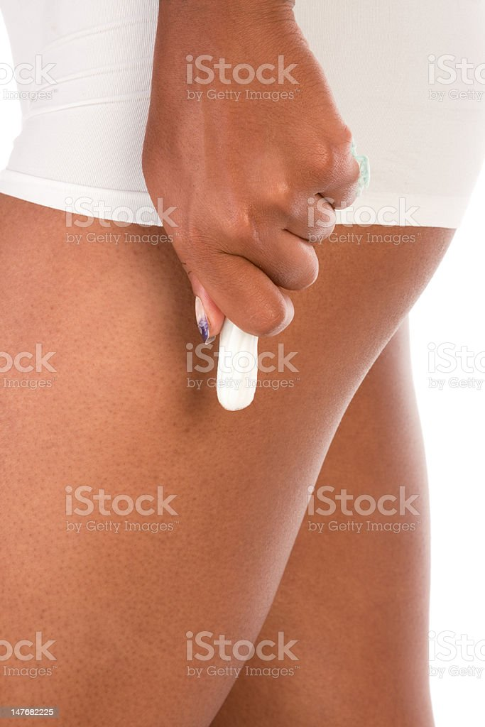 Woman hand hold white cotton hygienic tampon royalty-free stock photo