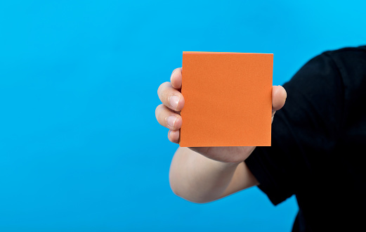 Woman hand holding a blank paper