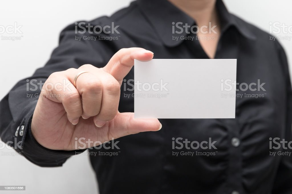 Woman hand holding a business card stock photo