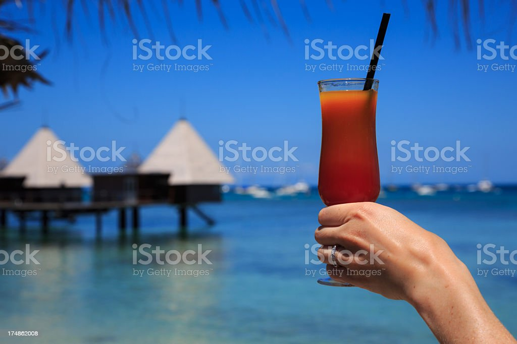 Woman Hand Holding a Cocktail at Tropical Resort royalty-free stock photo