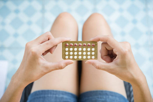 Woman hand holding a contraceptive panel prevent pregnancy stock photo