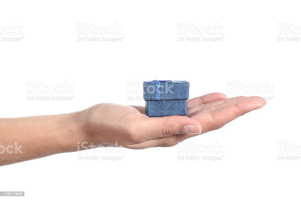 Woman hand holding a gift box stock photo