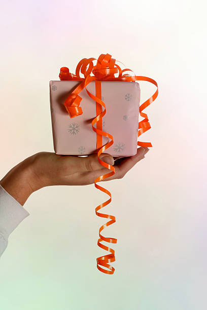 Woman hand holding a gift stock photo