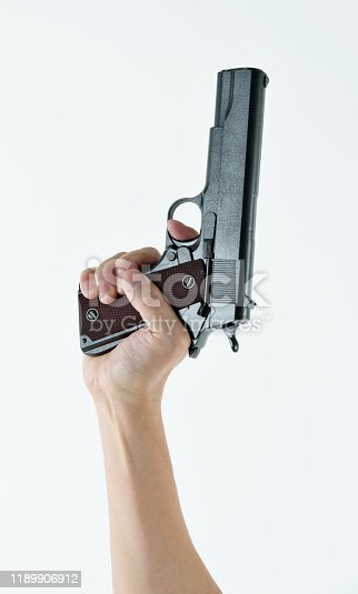 Woman hand holding a gun on white background.