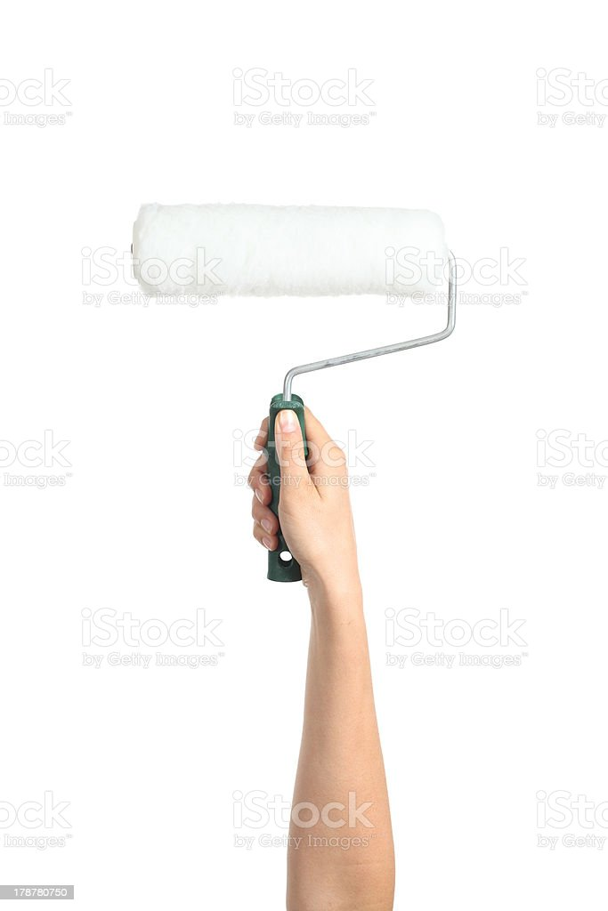 Woman hand holding a paint roller stock photo