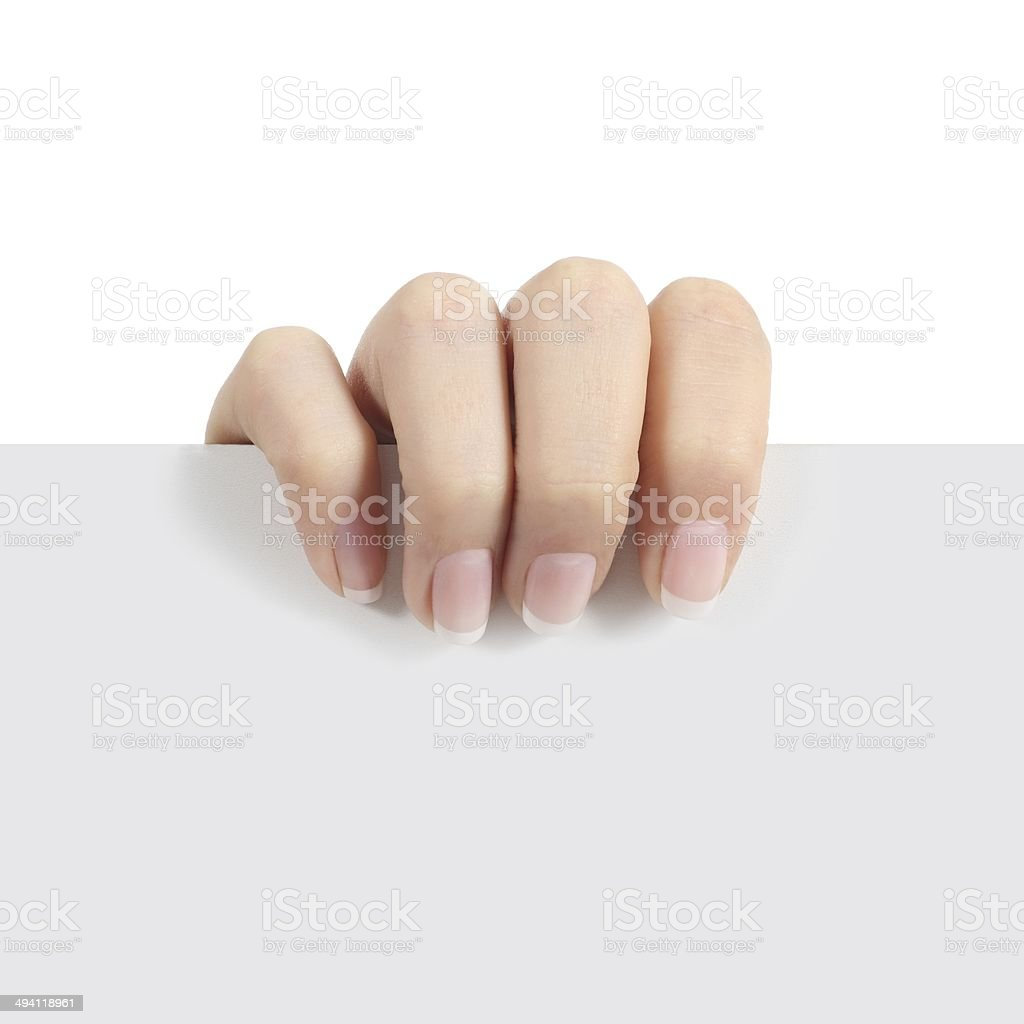 Woman hand holding a sign stock photo