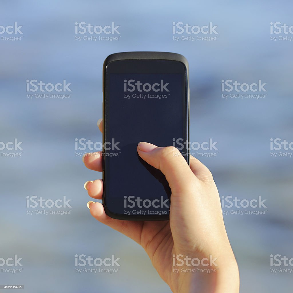 Woman hand holding and showing a blank smart phone screen stock photo