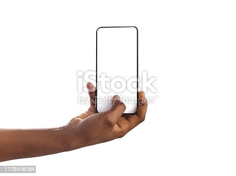 950613878 istock photo Woman hand holding and touching blank smartphone screen with thumb 1175416184
