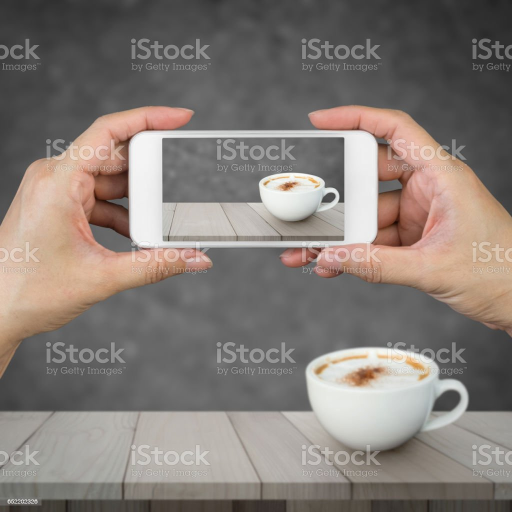 Woman hand holding and using mobile,cell phone,smart phone with isolated screen. stock photo