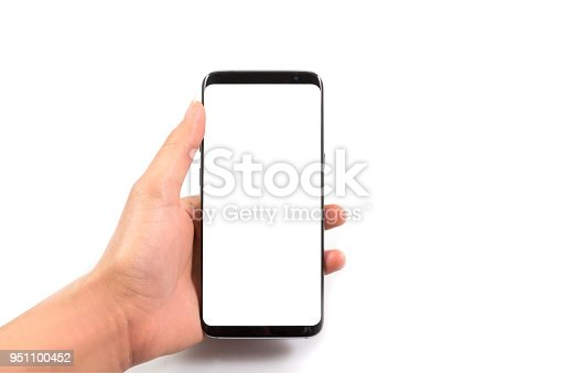 534217898istockphoto Woman hand holding and using new and modern smartphone with white screen, isolated on white background with clipping path top view. 951100452