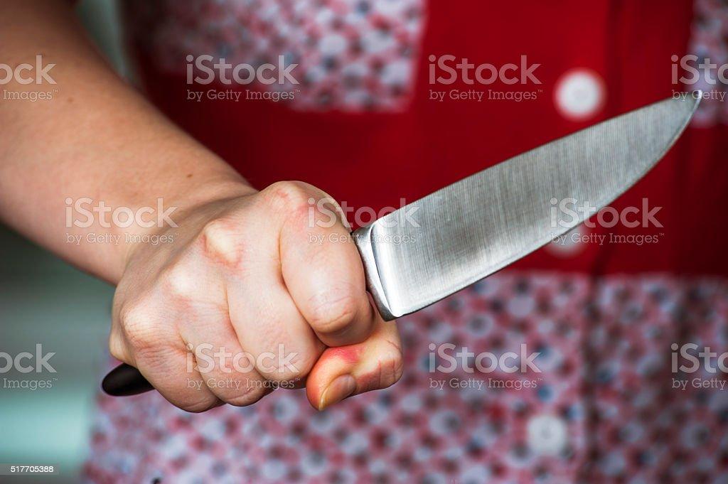 Woman hand holding big knife stock photo