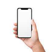Woman hand holding new black smartphone with blank screen and modern frameless design, isolated on white background