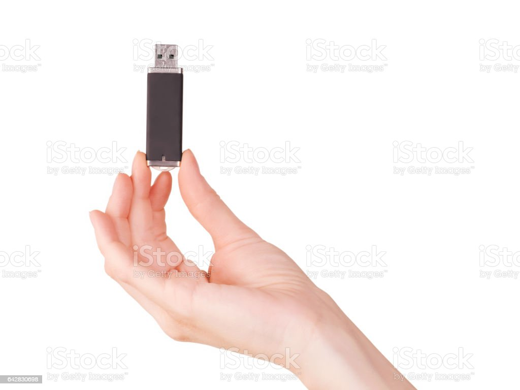 Woman hand holding flash pc card. stock photo