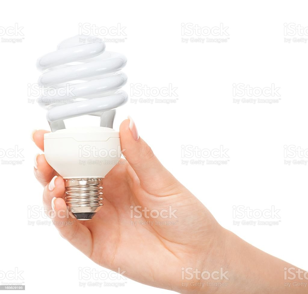 Woman hand holding Fluorescent light bulb isolated royalty-free stock photo