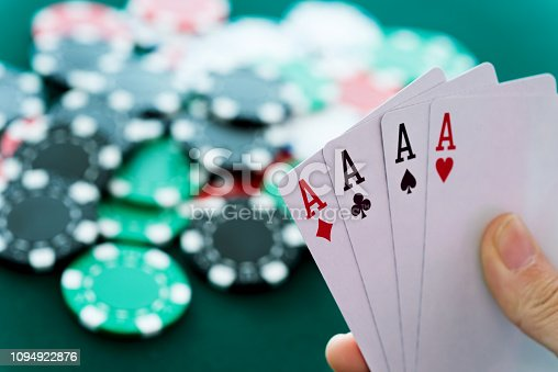 Woman hand holding four aces.