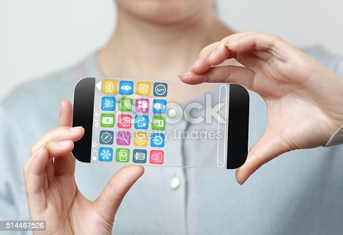 171347585 istock photo Woman hand holding futuristic transparent mobile smart phone 514467526