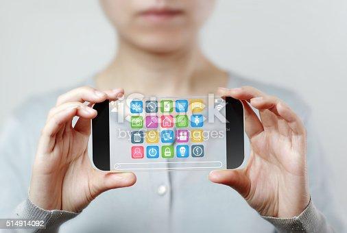 istock Woman hand holding futuristic transparent mobile smart phone 514914092