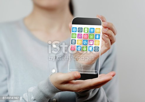 171347585 istock photo Woman hand holding futuristic transparent mobile smart phone 514914162