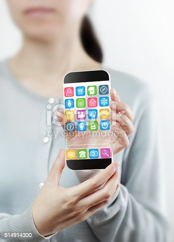 499253490istockphoto Woman hand holding futuristic transparent mobile smart phone 514914300