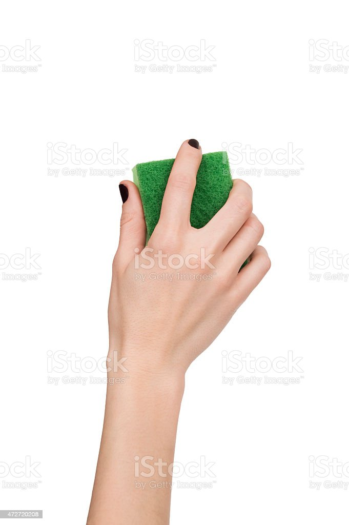 woman hand holding green sponge isolated over white stock photo