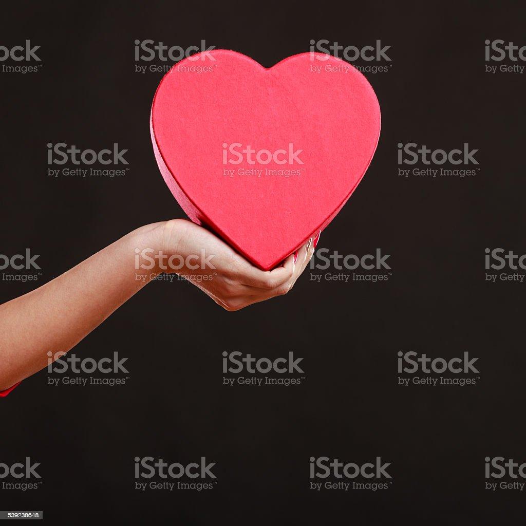 Woman hand holding heart box. royalty-free stock photo