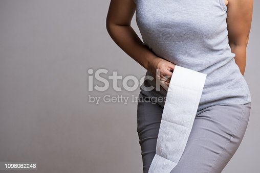 1045838148 istock photo Woman hand holding her bottom and tissue or toilet paper roll. Disorder, Diarrhea, Constipation. Healthcare concept. 1098082246