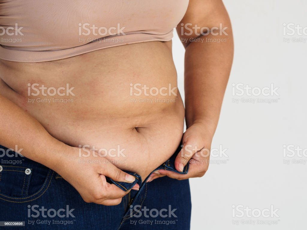 woman hand holding her own belly fat. woman diet lifestyle to reduce...