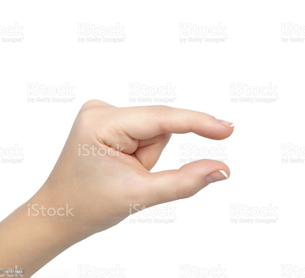 A woman hand holding her thumb index finger close together stock photo