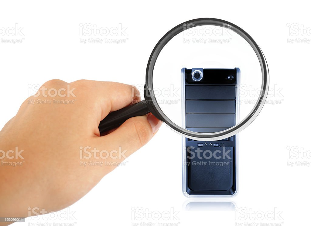woman hand holding Magnifying glass over computer royalty-free stock photo
