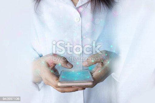 istock Woman hand holding mobile phone data synchronization 942697106