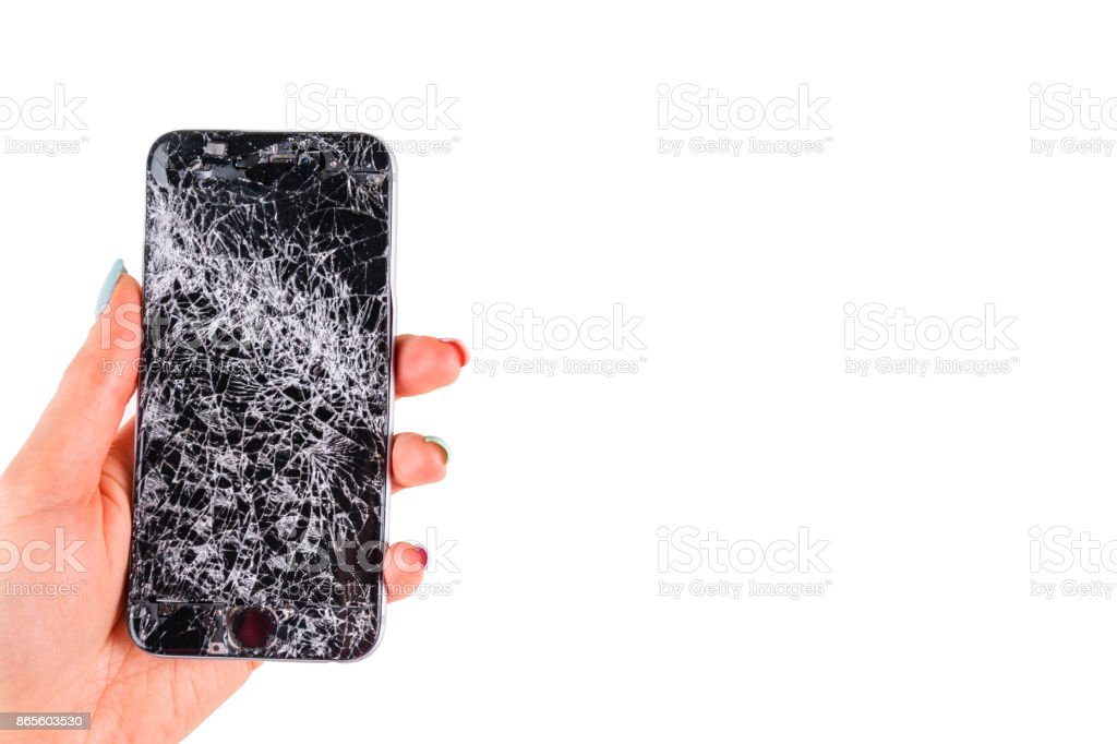 Woman hand holding modern mobile smartphone broken screen and damages. Cellphone crashed and scratch. Device destroyed. Smash gadget, need repair. white background stock photo