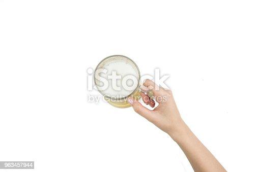 1144550840istockphoto Woman Hand Holding Mug Full Of Beer On White Background 963457944