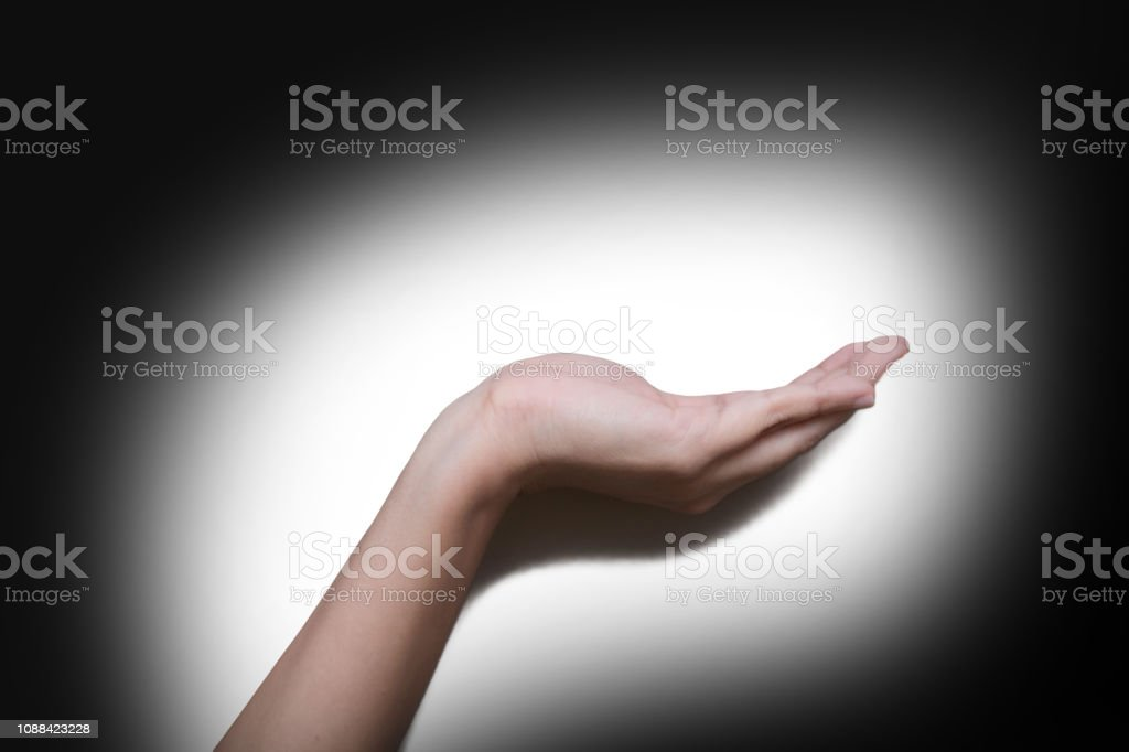 Woman hand holding or presenting something on the palm of her hand....