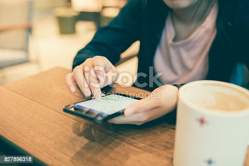 istock Woman hand holding phone 827896318