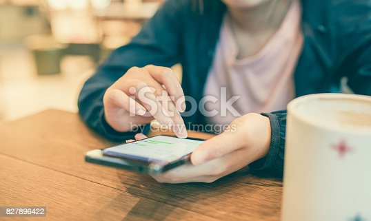 istock Woman hand holding phone 827896422