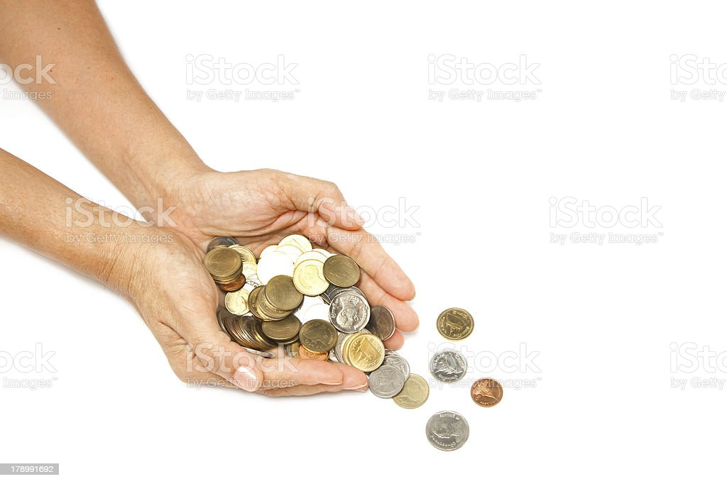 woman hand holding pile of coins royalty-free stock photo